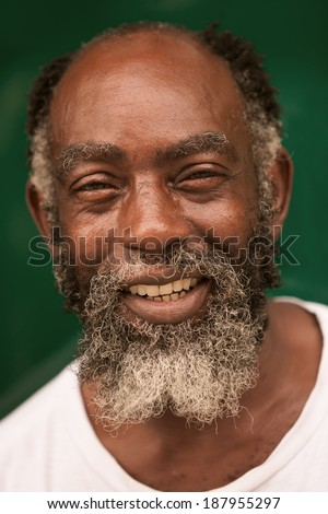 WARM LOOK OF AN AFRO MAN SMILING AT CAMERA  - stock photo