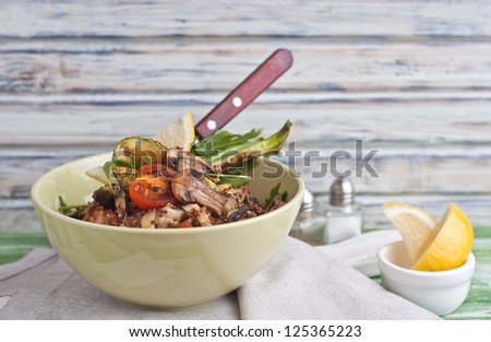 Warm red quinoa salad with grilled vegetables - stock photo