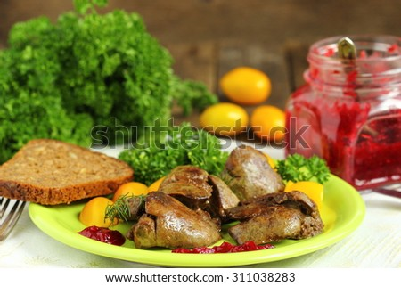 Warm salad with chicken liver, sweet peppers, cherry tomatoes and salad mix - stock photo