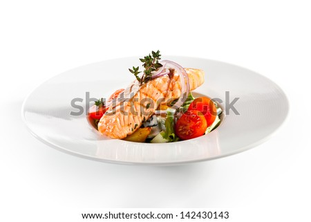 Warm Salad with Salmon Steak - stock photo