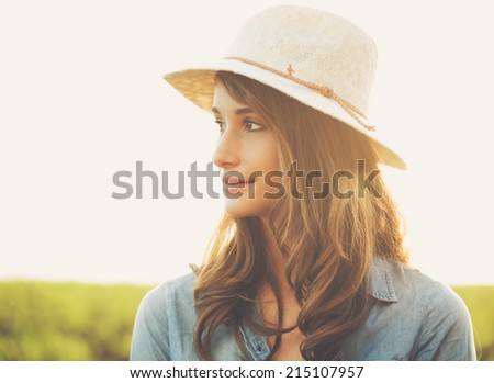 Warm Sunny Portrait of Beautiful Young Woman in the Countryside - stock photo