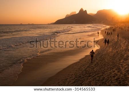Warm Sunset in Ipanema Beach, Rio de Janeiro, Brazil - stock photo