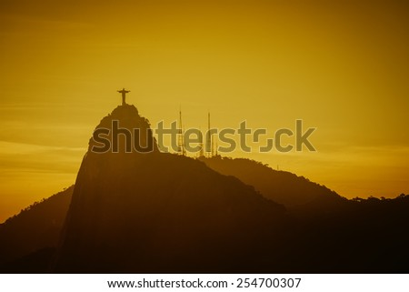 Warm Sunset with Christ Redeemer silhouette in Rio de Janeiro, Brazil - stock photo