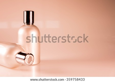 Warm Tone and Side View : Two aluminum bottles - stock photo