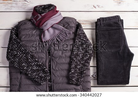 Warm winter clothes on a white wooden background. Winter collection. - stock photo