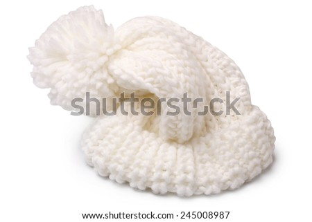 Warm woolen knitted hat with pompon on white background - stock photo