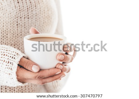Warming cup of coffee in the hands of women isolated - stock photo