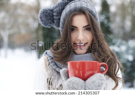 Warming up of gorgeous young woman in winter  - stock photo