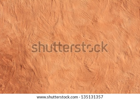 warmly toned mediterranean facade, wall with painted structured plastering - stock photo