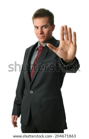 Warning businessmen holding his palm up isolated on white. Palm in focus. - stock photo