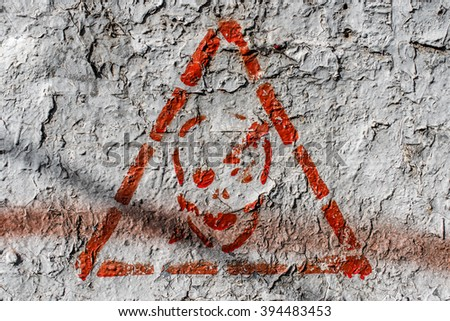 Warning danger sign on the wall close up - stock photo