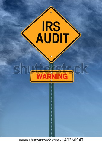 warning irs audit conceptual road sign over sky - stock photo