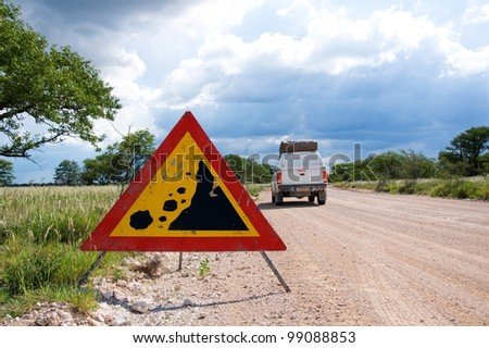 Warning of road sign of falling stones, Namibia - stock photo