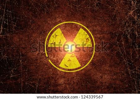Warning radiation sing on dark dirty wall - stock photo