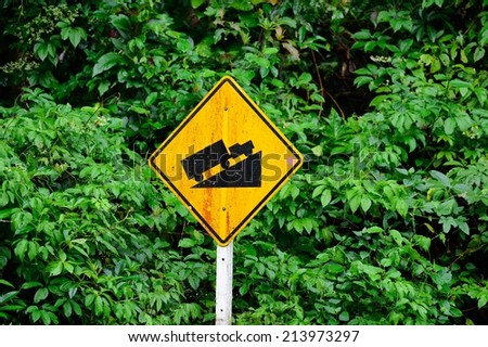 Warning road sign up to hill.  - stock photo