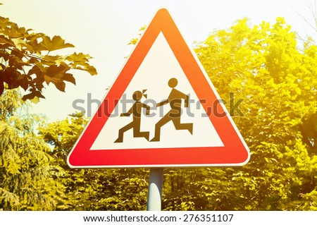Warning school sign near street - stock photo