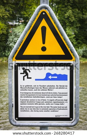 Warning sign cautioning against walking on the riverbed. - stock photo
