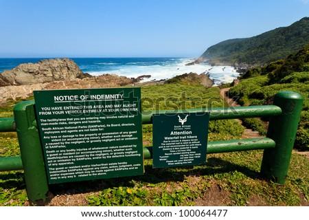 Warning sign for a dangerous coastline walking - stock photo