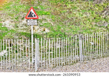 Warning sign for falling rocks from a cliff in the UK - stock photo
