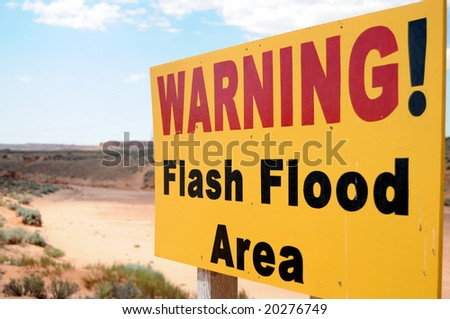 Warning sign for flash floods in a dry riverbed near Antelope Canyon in Page, Arizona - stock photo