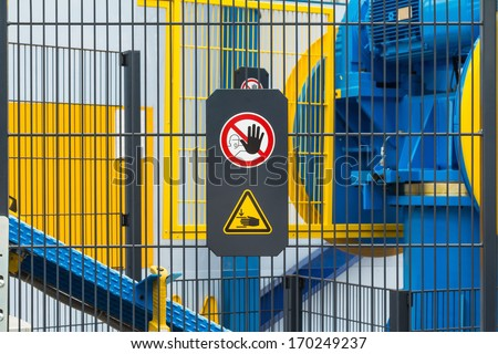 Warning sign for safety on machine, no entry and be careful of hand - stock photo