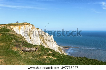Warning sign near cliff at Beachy Head, East Sussex, United Kingdom - stock photo
