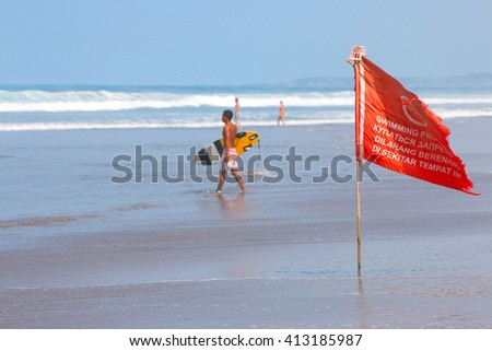 warning sign of a red flag at a beach - stock photo