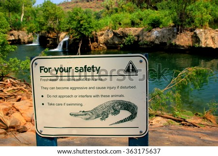 warning sign of crocodiles in the water - stock photo