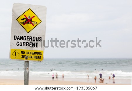 warning sign of dangerous current in ocean - stock photo
