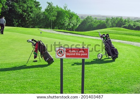 Warning sign on the golf course - stock photo
