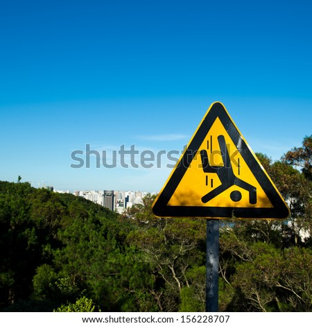 Warning sign on the top of mountains. - stock photo