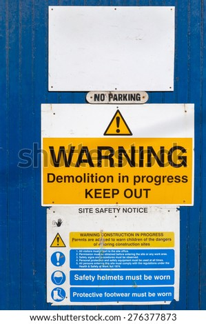 Warning signs at a construction site in  UK - stock photo