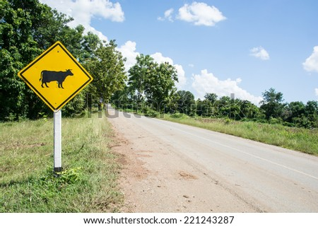 Warning signs of animals. the yellow animal warning sign with cow in it. - stock photo