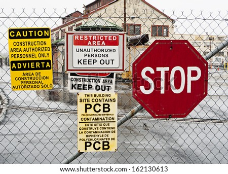 Warning signs outside hazardous industrial site - stock photo
