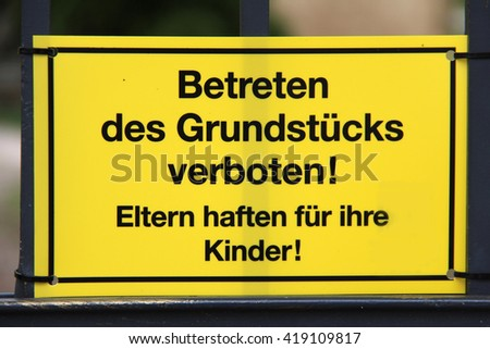 Warning / text on the sign: no trespassing the land! Parents are responsible for children! (German language). - stock photo