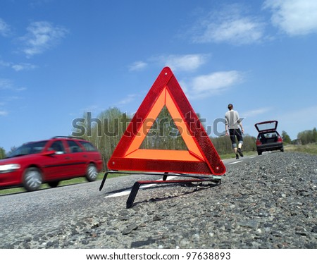 Warning triangle at the side of the road - stock photo