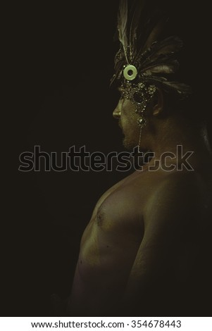 warrior helmet and gold feathers, giant iron sword - stock photo