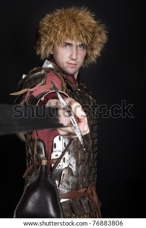 Warrior holding a sword and going to fight - stock photo