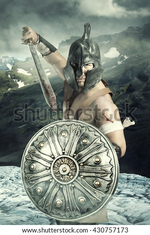 Warrior in a battle site in the mountains - stock photo