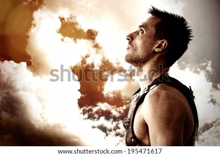 Warrior looking in the sky - stock photo