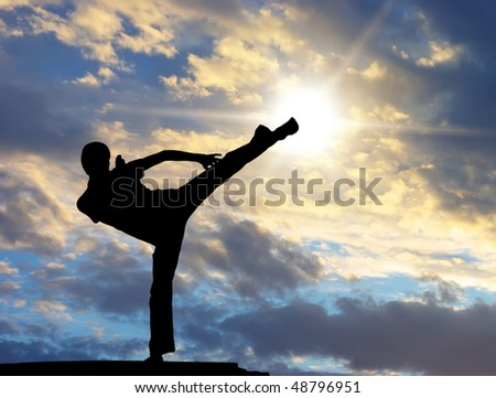 Warrior training at the sunset. Conceptual design. - stock photo