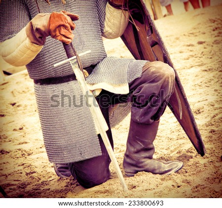 Warrior with a sworn during Historical Reconstruction of the Medieval knights Tournament - stock photo