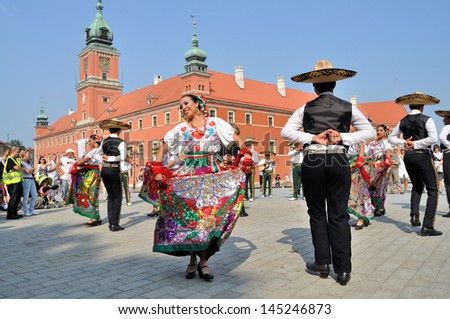 "WARSAW - AUGUST 27: Dancers of folklore ensemble ""VALLARTA AZTECA"" from Mexico - street parade during the International Folklore Festival ""WARSFOLK"" ; on August 27, 2011 in Warsaw, Poland. - stock photo"