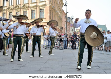 "WARSAW - AUGUST 27:  Mariachi band ""VALLARTA AZTECA"" from Mexico, play mexican music - street parade during the International Folklore Festival ""WARSFOLK"" ; on August 27, 2011 in Warsaw, Poland. - stock photo"