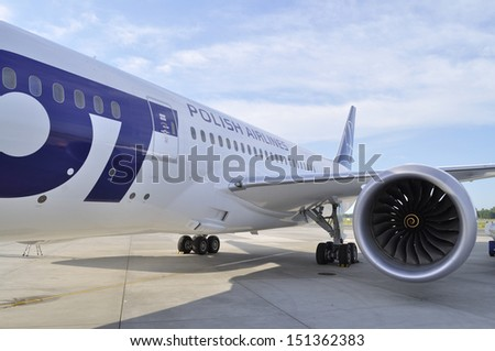 WARSAW - AUGUST 4: New Boeing 787 Dreamliner of the LOT Polish Airlines - prepare to departure at Chopin Airport on August 4, 2013 in Warsaw, Poland. - stock photo