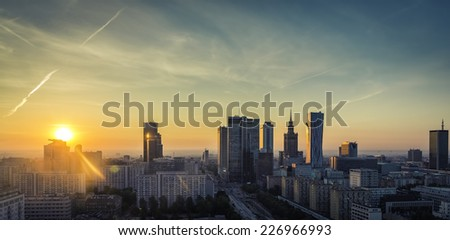 Warsaw financial center during sunrise, Poland - stock photo