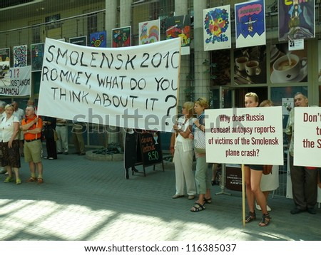 WARSAW - JULY 31: crowd challenges Mitt Romney to take stand on Russian investigation of Smolensk 2010 presidential plane crash, during his Warsaw visit on July 31, 2012 in Warsaw, Poland - stock photo
