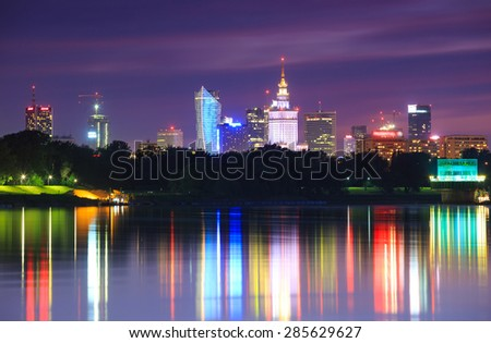 Warsaw night view of the city from the river - stock photo