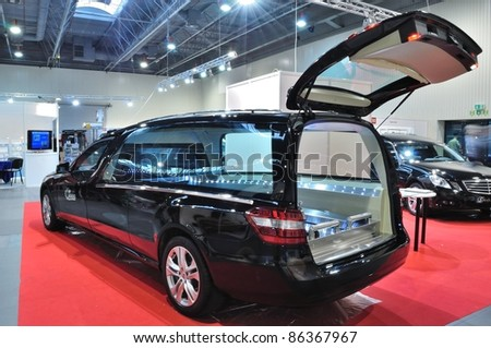 "WARSAW - NOVEMBER 20: Hearse limousine at the exhibition of funeral industry ""V Funeral Fair MEMENTO'2010"" on November 20, 2010 in Warsaw, Poland. - stock photo"