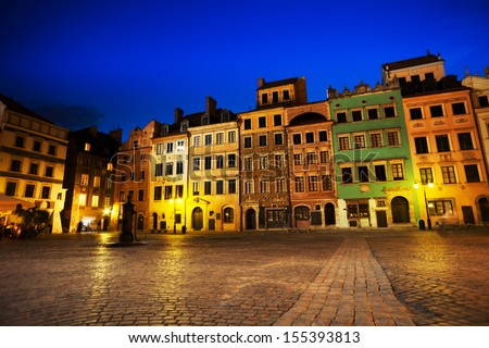 Warsaw old town marketplace square at night with colorful houses and stone pavement in Poland  - stock photo